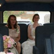 Happy bride and mom in Yesterday Spaces transport van