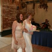 Mom escorts a happy bride